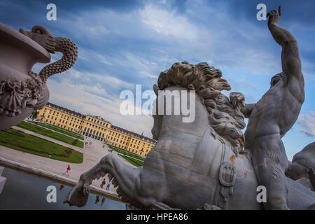 Schönbrunn Palace and gardens from Neptune fountain, Vienna, Austria, Europe - Stock Photo