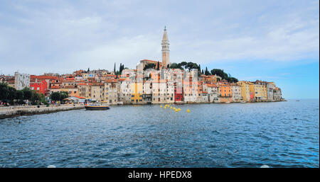 View of the medieval Rovinj, a picturescue town with colorful houses and characteristic church. - Stock Photo