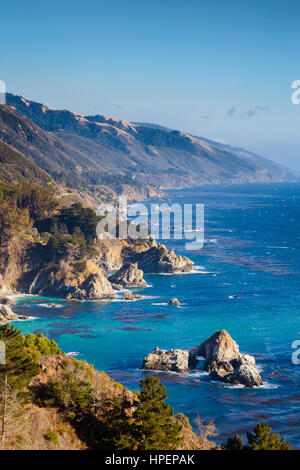 Scenic view of the rugged coastline of Big Sur with Santa Lucia Mountains along famous Highway 1 in beautiful evening - Stock Photo
