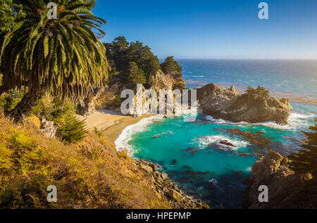 Classic postcard view of famous McWay Falls in golden evening light on a beautiful sunny day, Julia Pfeiffer Burns - Stock Photo