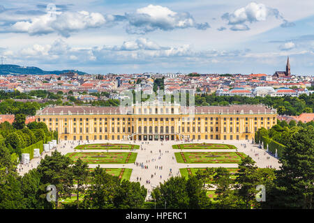 Classic view of famous Schonbrunn Palace with Great Parterre gardens on a beautiful sunny day with blue sky and - Stock Photo