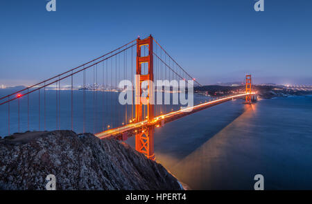 Classic panoramic view of famous Golden Gate Bridge seen from Battery Spencer viewpoint in twilight during blue - Stock Photo