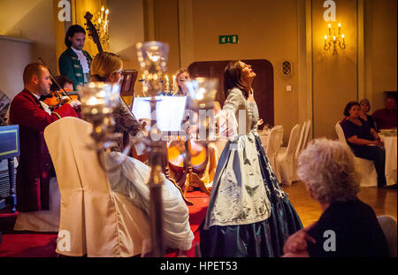 The Mozart Dinner Concert in the historic Baroque hall of Stiftskeller St. Peter, founded in 803 and thus the oldest - Stock Photo