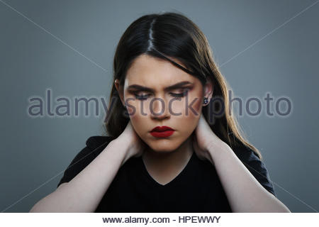 Young Female Having Headaches or Painful Neck - Stock Photo