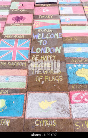 with chalk drawn flags of different countries on sidewalk tiles - Stock Photo