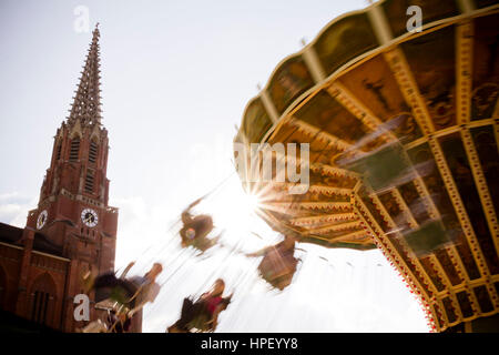Swing carousel on a public festival, relaxed leisure time fun for Young and old - Stock Photo
