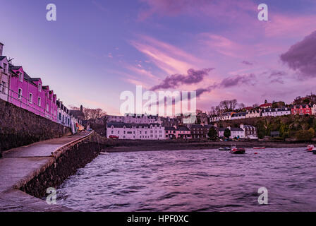 Looking towards the town from the jetty at Portree Harbour, Isle of Skye, Scotland, with the row of coloured houses - Stock Photo