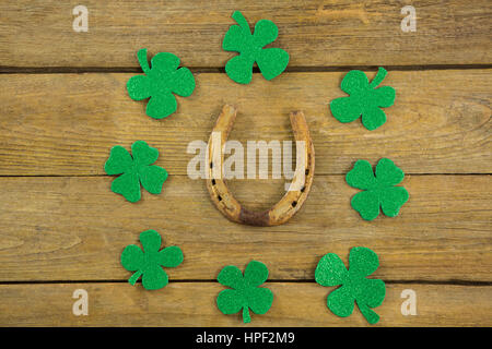 St Patricks Day horseshoe surrounded with shamrocks - Stock Photo