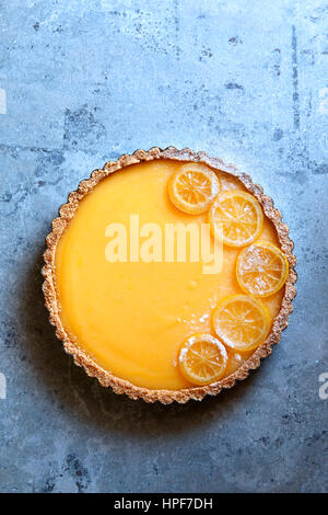 Classic lemon tart garnished with candied lemon slices.Top view - Stock Photo