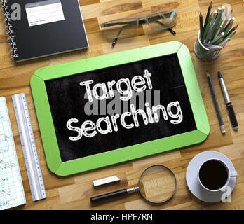 Target Searching Handwritten on Green Small Chalkboard. Top View of Wooden Office Desk with a Lot of Business and - Stock Photo