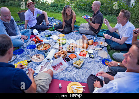 Tiergarten.Picnic.Friends eating in the evening.Berlin. Germany - Stock Photo