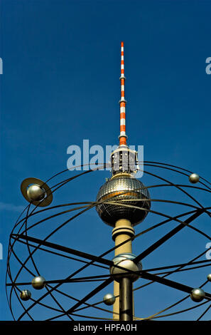 Alexanderplatz. Fernsehturm and The Universal Clock ´Urania´ .Berlin. Germany - Stock Photo