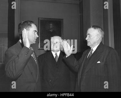 Richard M Nixon (left) being sworn in by Vice-President Alben Barkley (right) as the Republican Senator from California, - Stock Photo