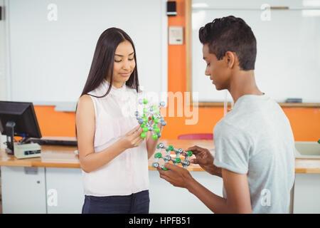 School students experimenting molecule model in laboratory at school - Stock Photo