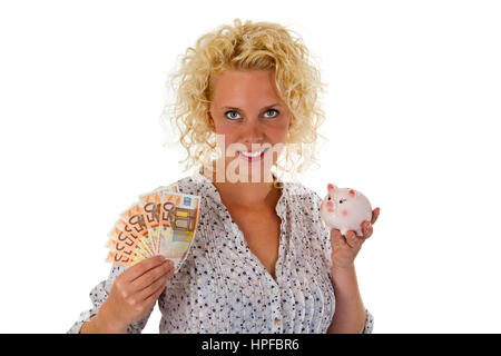 Young woman with piggy bank and euro banknotes - isolated on white background - Stock Photo