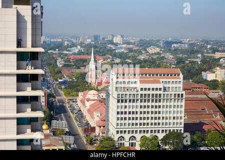 FMI Building and the Holy Trinity Anglican Church on Bogyoke Road, Yangon, Myanmar - Stock Photo
