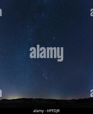 Starry sky with the Milky Way over the Swabian Alb, Münsingen, Baden-Württemberg, Germany - Stock Photo