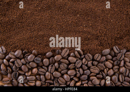 Close-up of coffee beans with roasted coffee powder - Stock Photo
