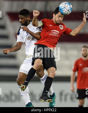 (170222) -- DOHA, Feb. 22, 2017 -- Qatar's AL Rayyan's Rodrigo Tabata (R) rises for head a high ball with UAE's - Stock Photo