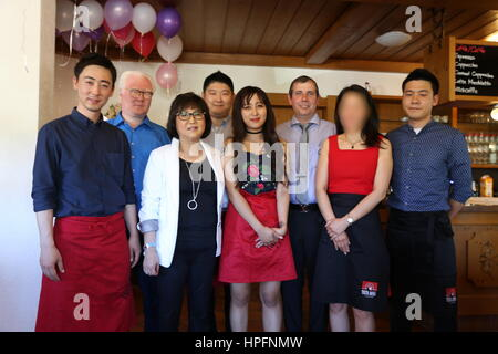 Choi Soon-sil (l), her daughter Chung Yoo-ra (Middle, red skirt) and Christian Kamplade (Manager Widec Sports GmbH) - Stock Photo