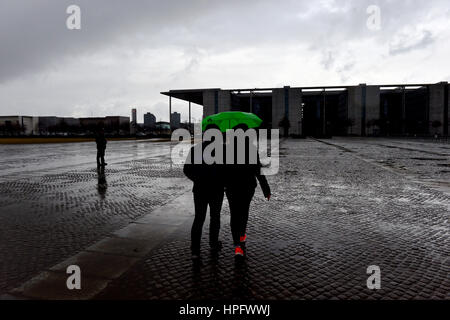 Berlin, Germany. 22nd Feb, 2017. Passers-by walking past the Paul-Loebe-Haus through pouring rain in Berlin, Germany, - Stock Photo
