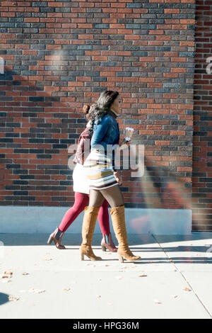 Two stylish young black woman walking with their coffee. St Paul Minnesota MN USA - Stock Photo