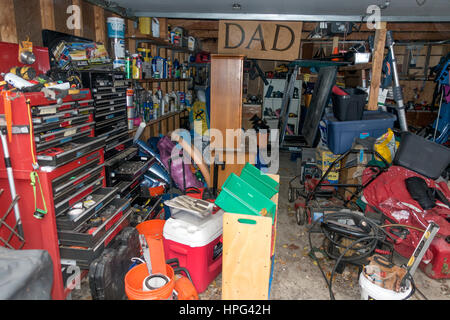 Working man's garage with two tall stacks of cabinets and drawers filled with tools. Downers Grove Illinois IL USA - Stock Photo