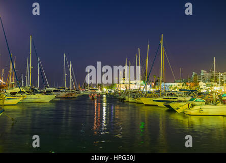 EL KANTAOUI, TUNISIA - AUGUST 28, 2015: The rows of white yachts rock on the gentle waves in port, on August 28 - Stock Photo