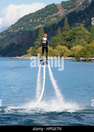 Queenstown, Otago, New Zealand. Flyboarding in Queenstown Bay, Lake Wakatipu. - Stock Photo