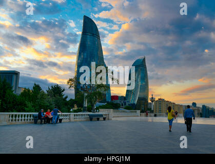 Baku, Azerbaijan - September 11, 2016: View on Flame Towers from Upland park in the evening. Towers consist of three - Stock Photo