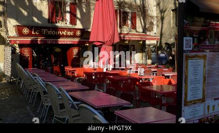 Notice board menu and tables and chairs outside restaurant, Carcassonne, South West France - Stock Photo
