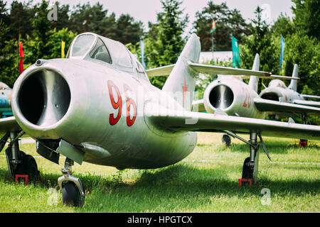 Old Russian Soviet Supersonic Military Plane Aircraft Fighter-bomber Stands At Aerodrome - Stock Photo