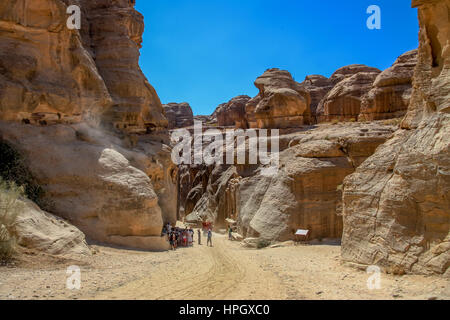 Entrance to canyon Siq passage in Petra, Jordan - Stock Photo