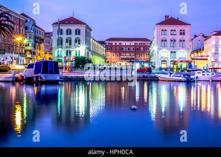 Waterfront evening view at coastline city Split in Croatia, long exposure. - Stock Photo