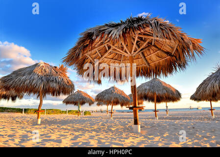 Amazing tropical holidays. Sun umbrellas on the beach. Tropical paradise. Caribbean. Punta Cana. Dominican Republic - Stock Photo