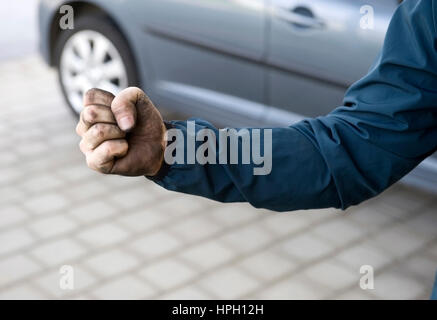 Model released , Geballte Faust eines Handwerkers - clenched fist of a workman - Stock Photo