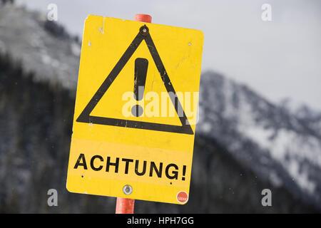 Schild Achtung - warning shield - Stock Photo
