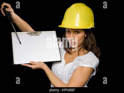 Junge Frau mit Bauarbeiterhelm - young woman with work helmet, Model released - Stock Photo