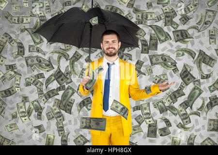 young businessman is very rich, money rain - Stock Photo
