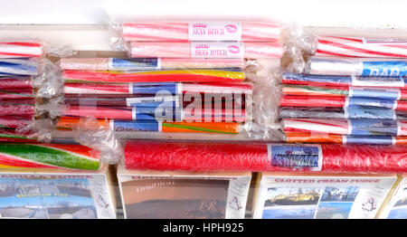 Colourful sticks of rock on sale in Brighton seaside resort gift shop UK - Stock Photo