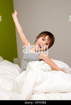 little boy wakes up in the morning stock photo royalty. Black Bedroom Furniture Sets. Home Design Ideas