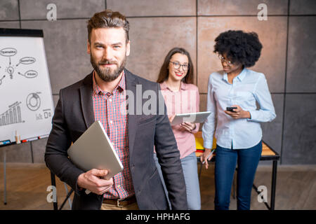 Businessman's portrait at the office - Stock Photo