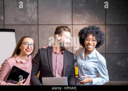 Portrait of multi ethnic coworkers - Stock Photo
