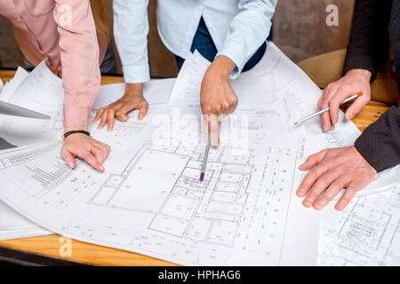 Working on architectural drawings - Stock Photo