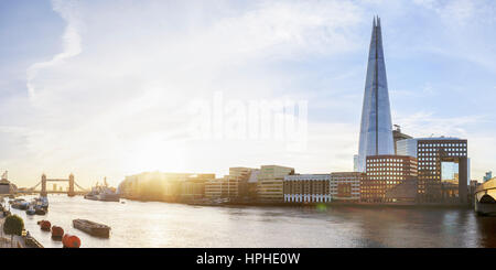 Sunrise over River Thames with view of the Shard and Tower Bridge, London, UK - Stock Photo