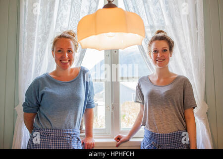 waitresses, in coffe shop of  Alnes Lighthouse, Alesund, More og Romsdal, Norway - Stock Photo