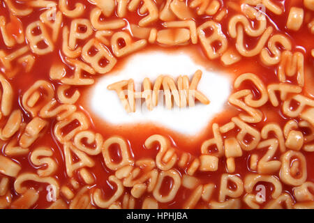 Think written in spaghetti pasta letters surrounded with jumbled letters. - Stock Photo