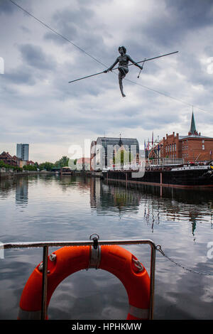 View from a boat, sculpture called 'Crossing the River' over Brda river, Bydgoszcz, Poland. - Stock Photo