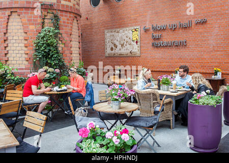 Out door cafe in Old Brewery, Stary Browar, modern shopping center, Poznan, Wielkopolska, Poland, Europe. - Stock Photo