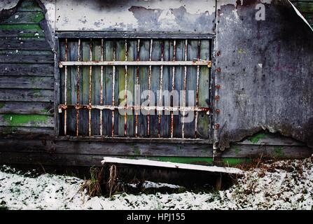 Bars in the window, old forgotten cottage in Poland. - Stock Photo